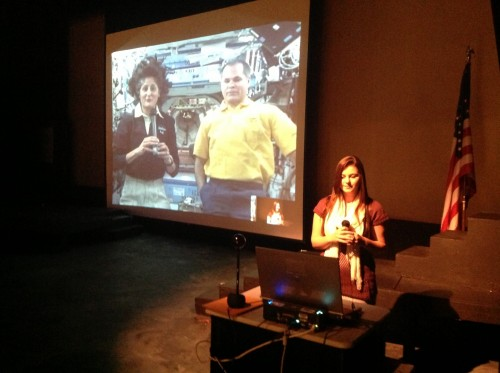 On November 15, 2012, during a live video-conference with the International Space Station, Traverse City West Senior High School 11th grade SSEP researcher Kelsey Cosens asks Station Commander Sunita Williams and astronaut Kevin Ford a question. Over 12,400 participated in the live event across 25 SSEP communities.