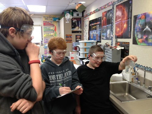 Student researchers assessing required volumes of water and ethanol fixative.