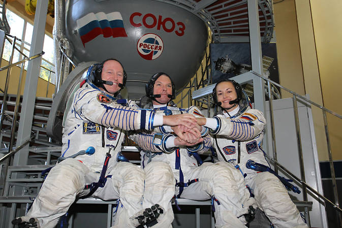 Expedition 42 commander Barry Wilmore of NASA (left), Alexander Samokutyaev of the Russian Federal Space Agency (Roscosmos) and Elena Serova of Roscosmos, seen here at the Gagarin Cosmonaut Training Center in Star City, Russia, just weeks before their launch to the International Space Station, are scheduled to return to Earth March 11, 2015. Image Credit: NASA/Stephanie Stoll